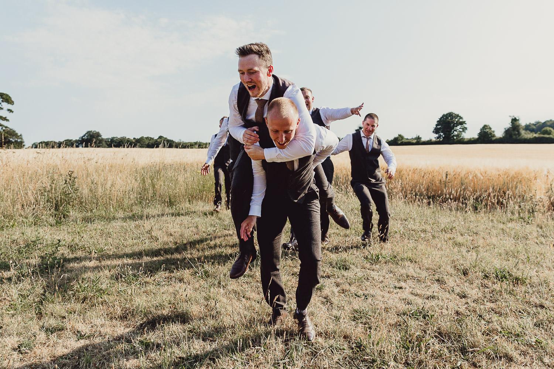 Norfolk norwich  wedding groomsmen outdoors having fun