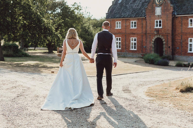 Norfolk norwich  wedding bride and groom walking