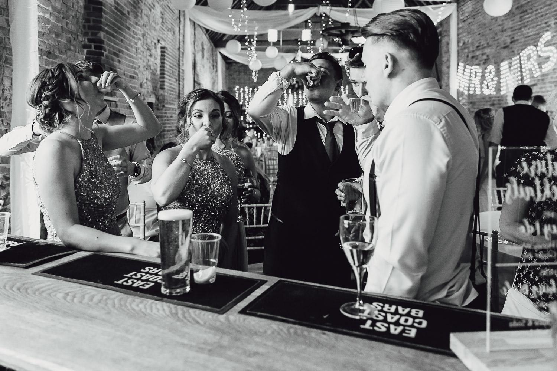 Norfolk norwich  wedding guests doing shots