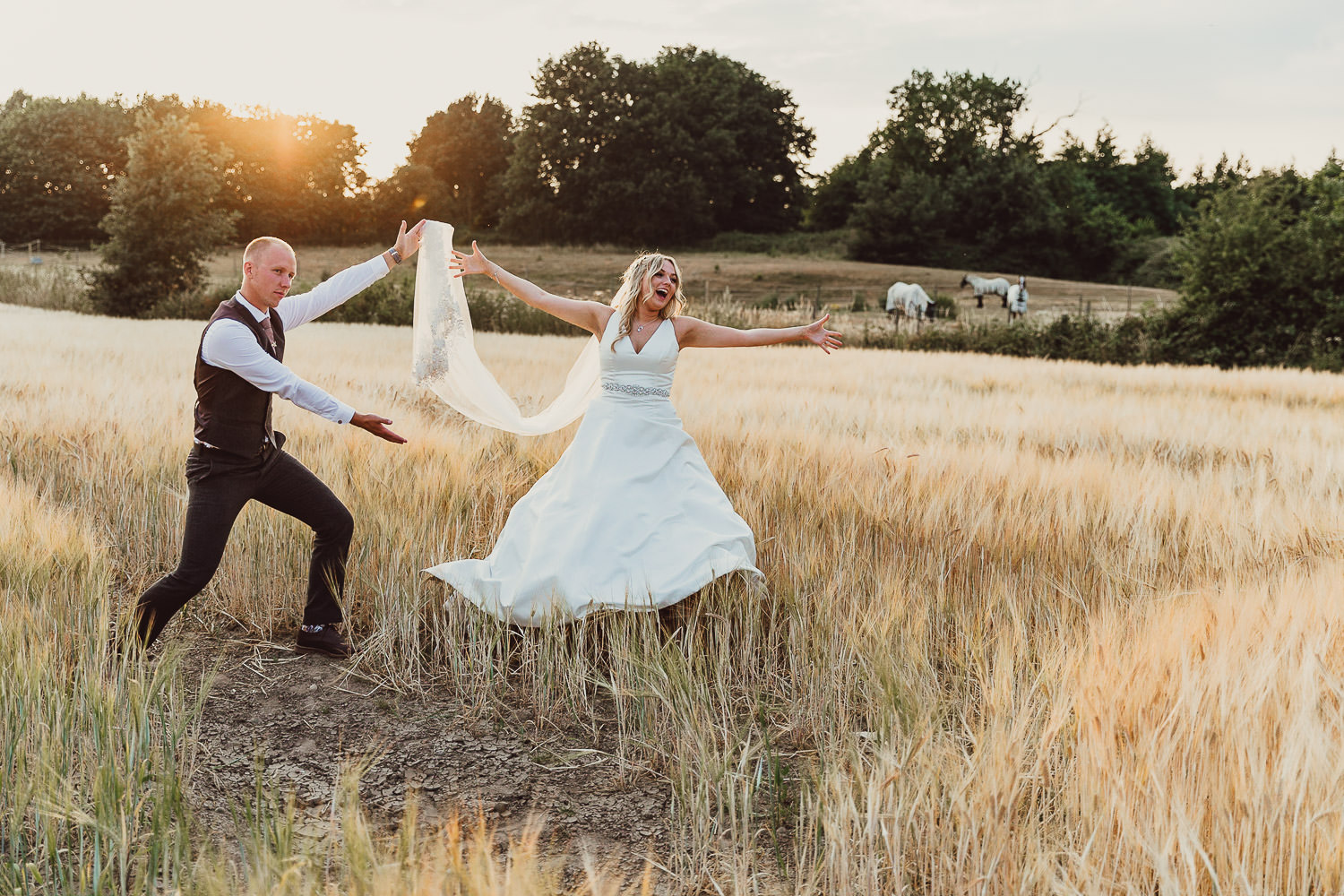 Norfolk norwich  wedding bride and groom in field at sunset dancing