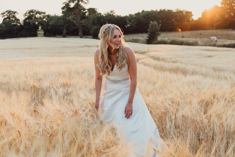 Norfolk norwich  wedding bride in field at sunset