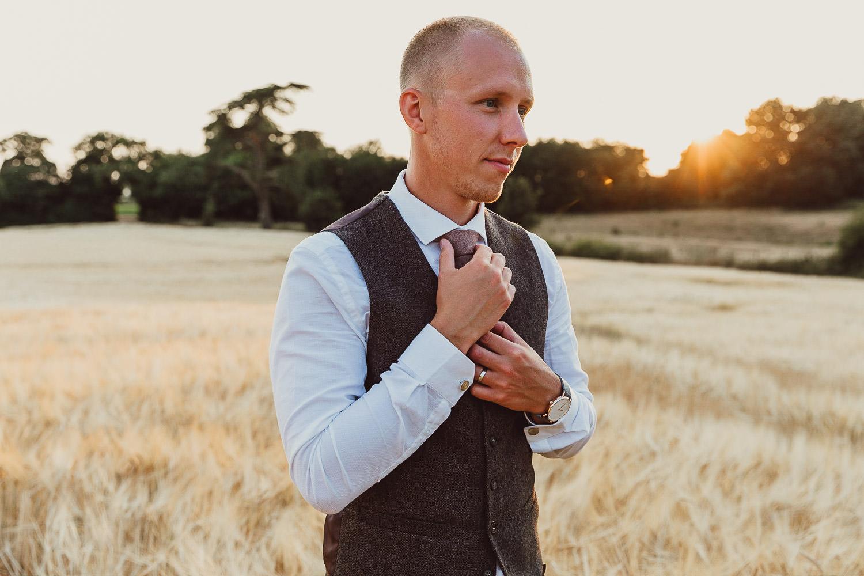 Norfolk norwich  wedding groom doing tie