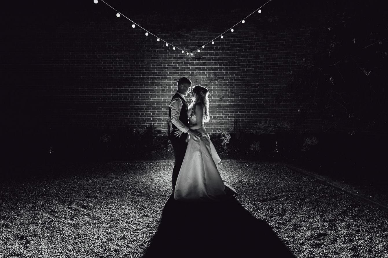 Norfolk norwich  wedding bride and groom at night under festoon lighting