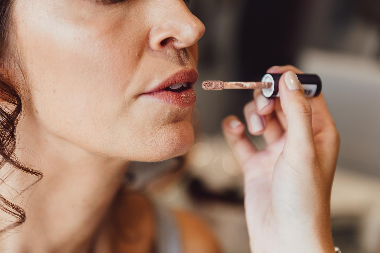 Norfolk norwich  wedding bride having lipstick done