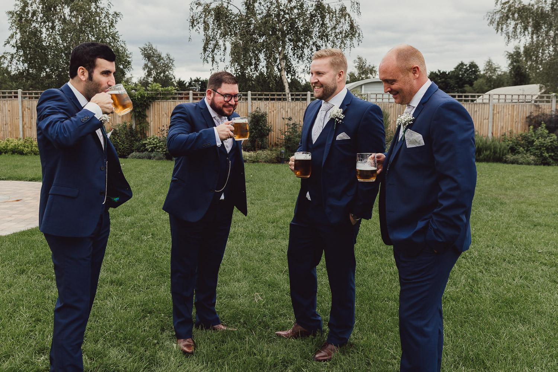 Norfolk norwich  wedding groomsmen outside with beer
