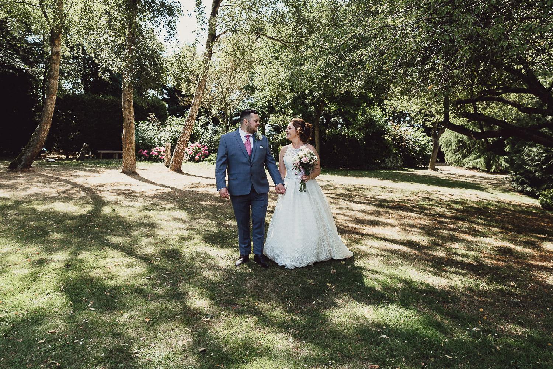 Norfolk norwich  wedding bride and groom walking in garden