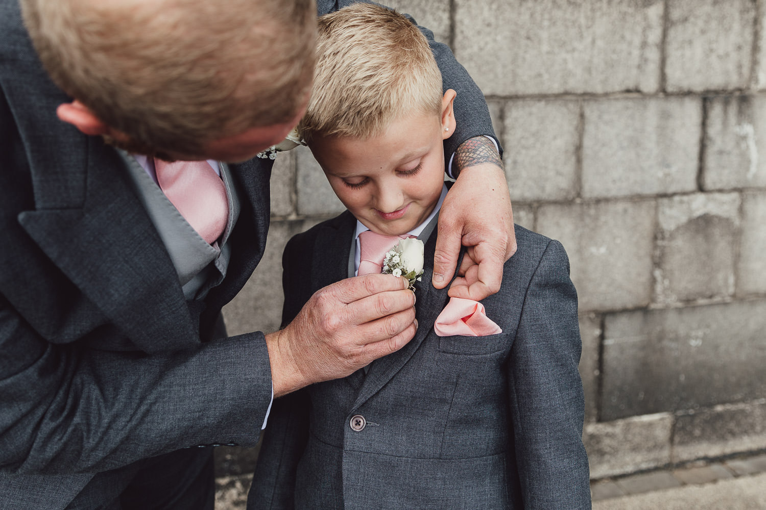 Norfolk norwich  wedding pinning on sons button hole