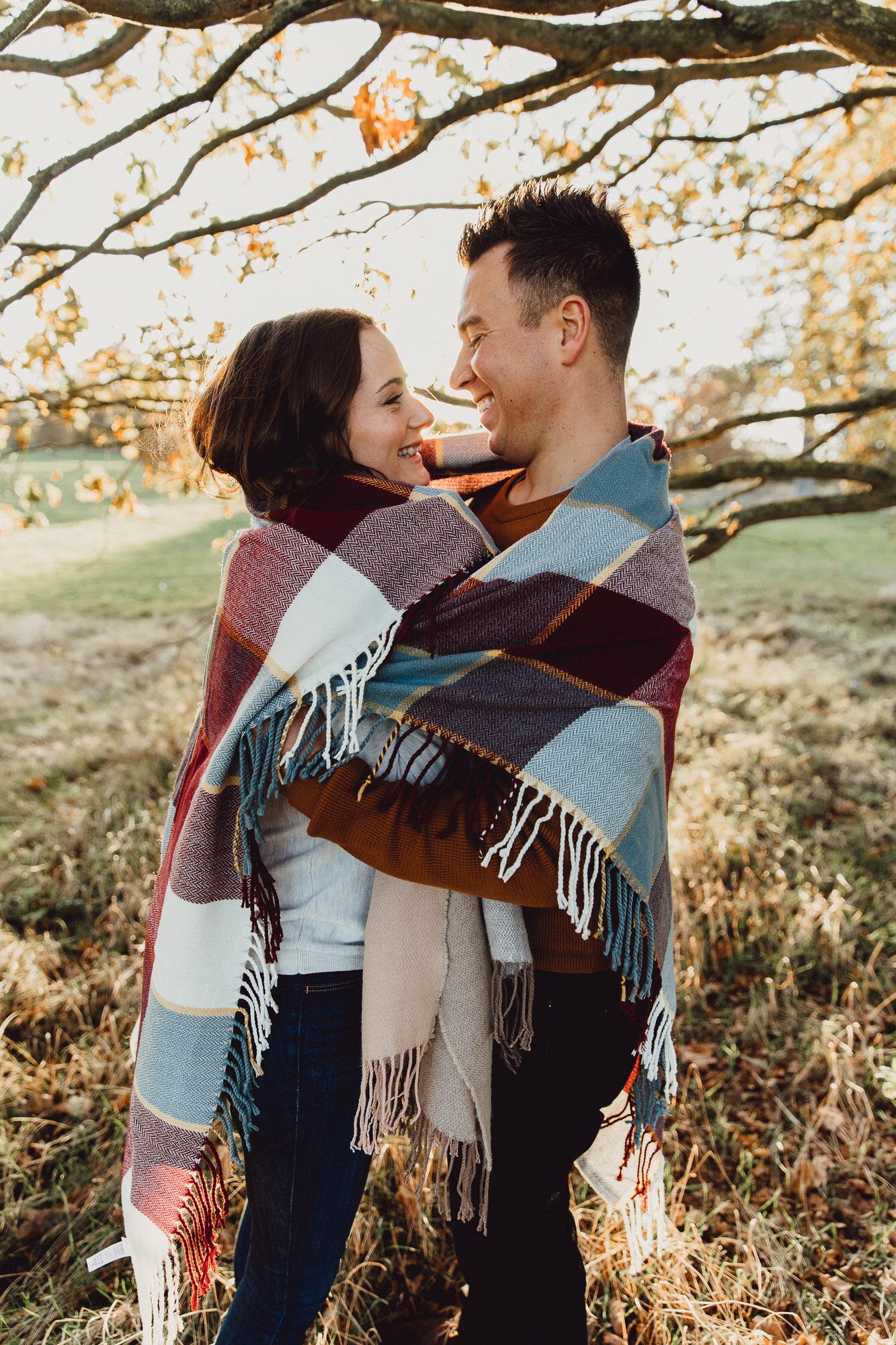 Engagement shoot Norfolk golden hour autumn wrapped in a blanket