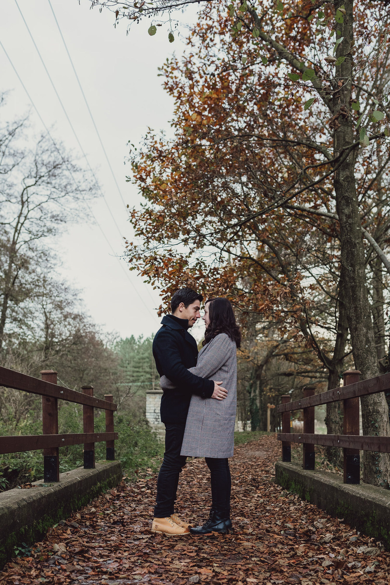 Engagement shoot Norfolk golden hour autumn standing on a bridge