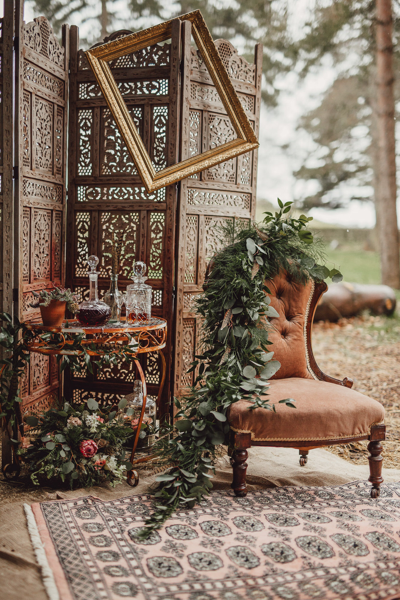 country boho luxe wedding norfolk whiskey bar and chair outdoors