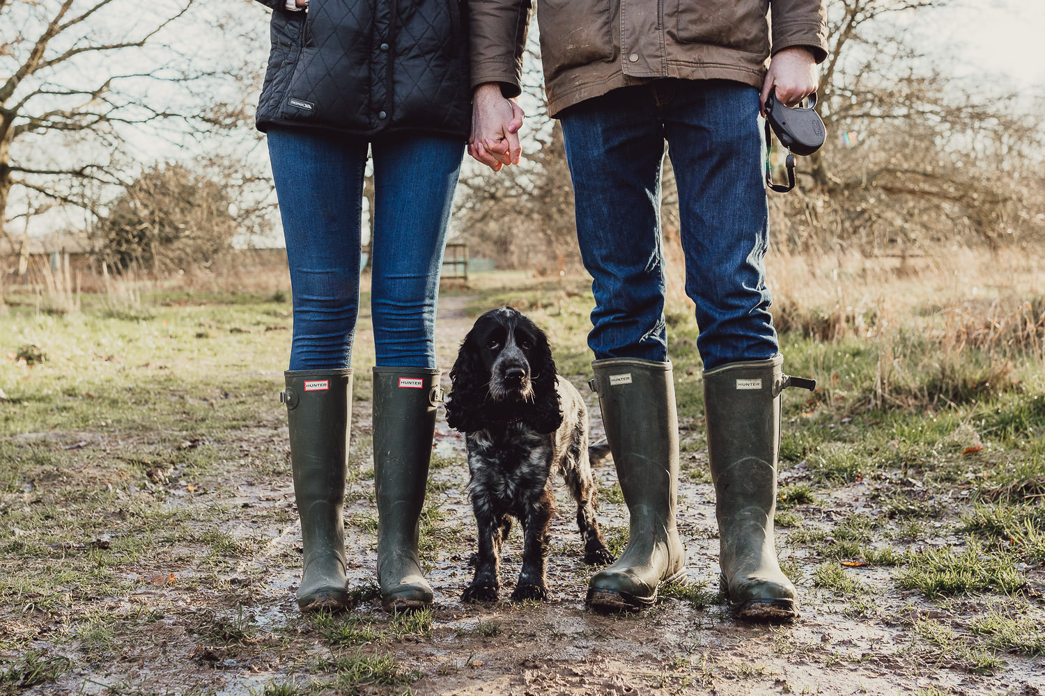 Norfolk woodland and Lake engagement shoot in wellies an with dog